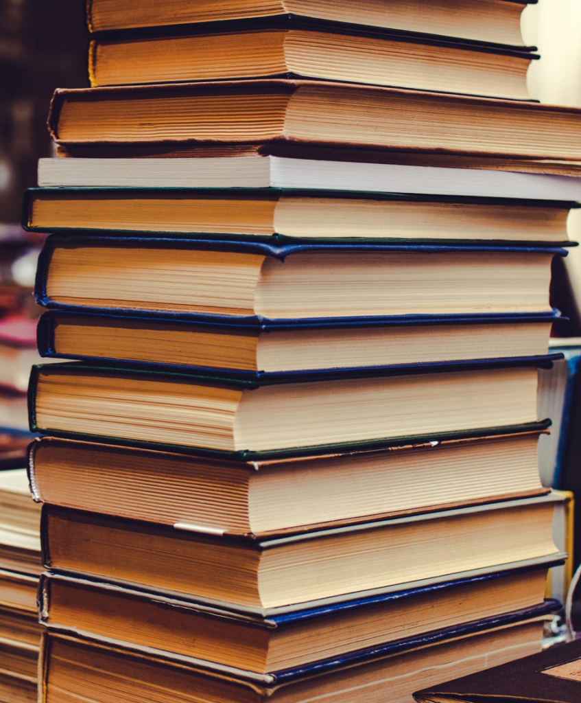 stack of books. image courtesy of @Artem Beliaikin at pexels.com.