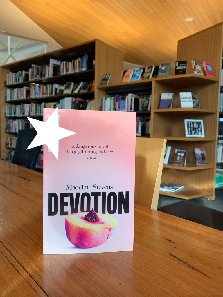 "image of madeline stevens's book ""devotion"" with a sticker over the library barcode haha be gone library barcode!!"